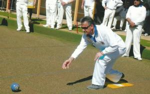 Alan Baker ( club champion ) Rolls the first bowl 2014/2015 season